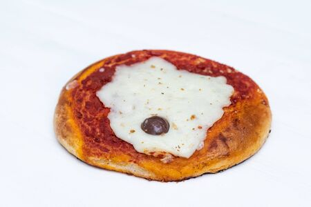 Sicilian Pizzetta. A typical street food from Sicily. Made with olive, tomato, and cheese. Stock fotó