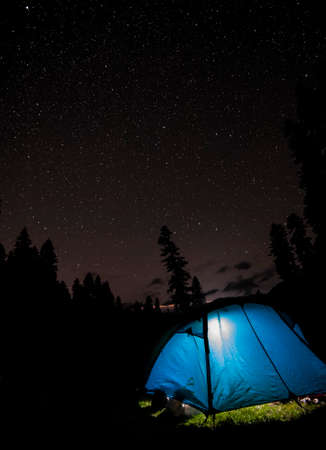 caucas: A starry night sky high in the mountains and a tent.