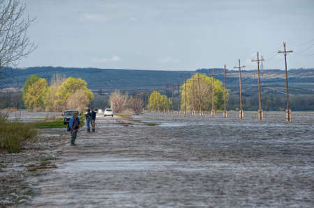 The flood of the river Don. Dangerous water level on the road towards Tryokhostrovskaya ferry station, Ilovlinsky district. Stock Photo