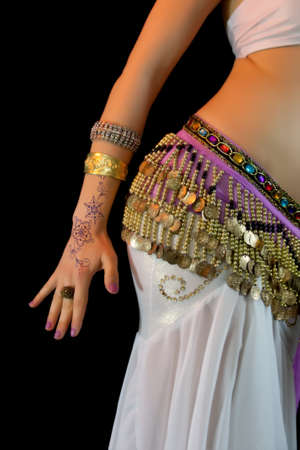 Young Belly Dancer mid section close up photo