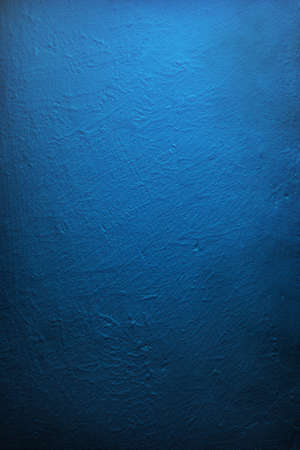 cement texture: Gradient illuminated deep blue wall, textured. Stock Photo