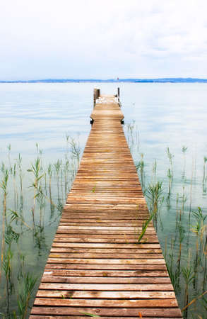 quietude: Frontal clean perspective shoot of antique lakes jetty.
