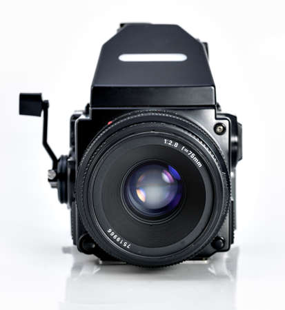 Vintage medium format camera on white background photo