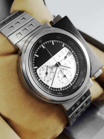 Chronograph wrist watch with metal or leather strap. Swiss made.
