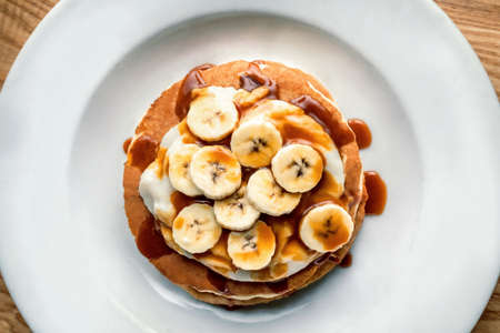 Breakfast oatmeal pancakes with banana, walnuts and honey Stock fotó