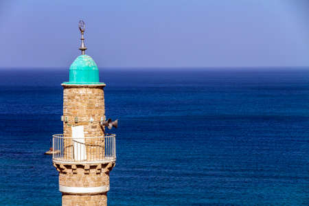 jaffa: The turret of El Baher mosque in front of the mediterranean sea, Jaffa, Israel Stock Photo