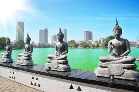 Buddha Statues in  Gangarama seema malakaya Temple Sri Lanka 스톡 콘텐츠
