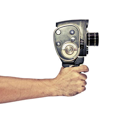 Hand holding retro video camera in vintage style Stock Photo