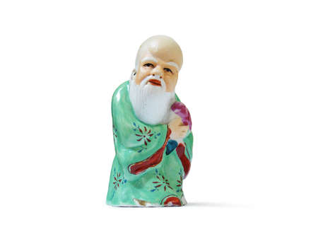 Small statue of old asian man Stock Photo
