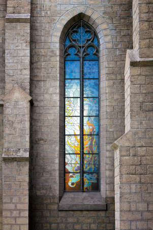 Stained-glass vitrage window in catholic church photo