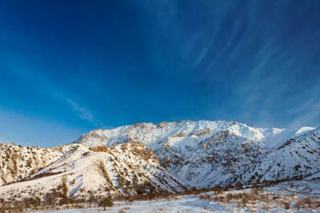 foothill: Picturesque mountain alps partially covered by snow, late fall