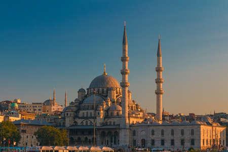 New Mosque in Istanbul on sunset near Bosporus strait photo