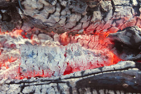 coals: Closeup of hot smoldering logs and ashes