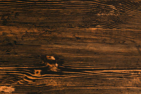 Aged dark wood texture background with shabby black paint