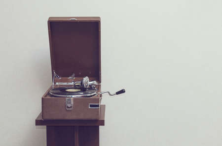 dj turntable: Old retro portable gramophone isolated, vintage style toned, with empty space