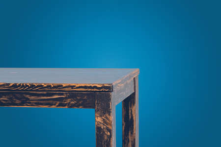 Part of empty wooden table isolated on blue