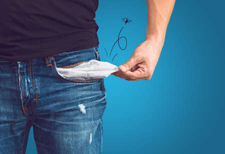 Poor man in jeans with empty pocket and drawn fly concept Stockfoto