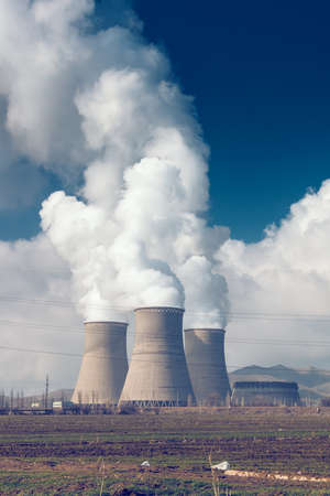 nuclear plant: Factory pipes with thick white smoke from heat energy nuclear plant polluting environment Stock Photo