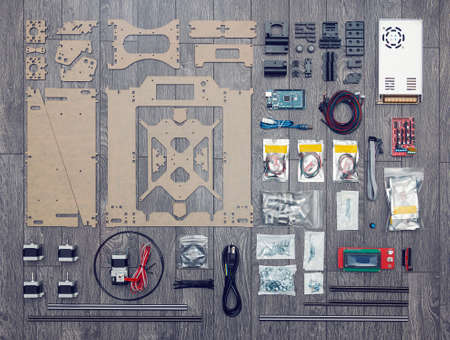 Flat lay of electronic and mechanical parts and components of DIY 3d printer on wooden surface Reklamní fotografie