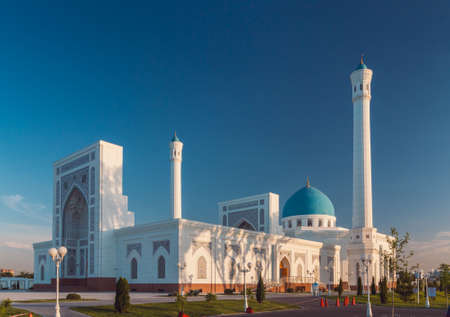 A big beautiful Mosque (Islamic temple) at sunset over blue sky, wide angle photo