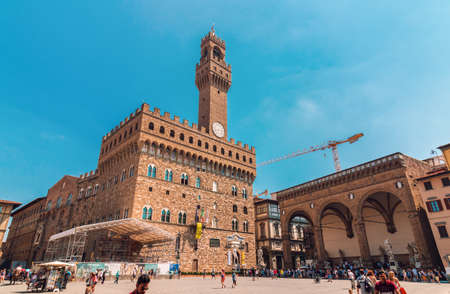 Florence, Italy - August 06, 2017: Palazzo Vecchio with lot of tourists in Florence, Italy, wide shot
