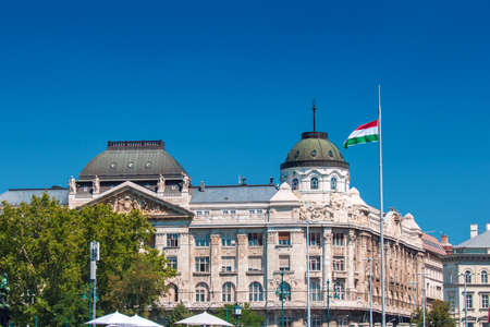 BUDAPEST, HUNGARY - AUGUST, 01, 2017: Ministry of interior of Hungary building with waving Hungary National flag in front of it