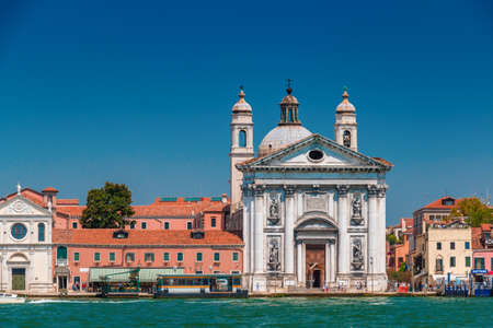 Venice, Italy - August, 04 2017: Santa Maria del Rosario Church with lot of tourists, view from Grand Canal in Venice