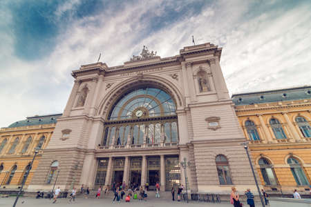 Budapest, Hungary - August 02, 2017: Budapest Keleti Railway Station on the morning with dramatic sky and lot of tourists, wide shot