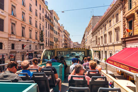 ROME, Italy - August 10, 2017: Tourists riding in bus, enjoy by tour in Rome Redakční