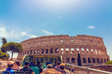 ROME, Italy - August 10, 2017: Tourists riding in bus, enjoy by tour in Rome, near Coliseum