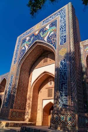 Closeup of Madrasah Nadir Divan Begi over blue sky, Bukhara, Uzbekistan