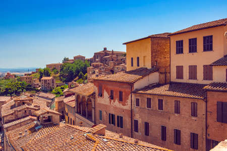 Beautiful italian town Siena with narrow lanes and streets and old roofs top view from above