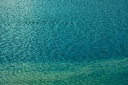 Beautiful green calm water waves, lake or sea water texture Reklamní fotografie