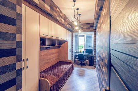 Modern interior design of small bedroom for teenager Reklamní fotografie