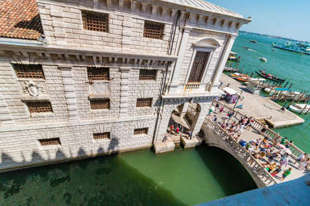 Venice, Italy - August, 04 2017: View of canal in Venice and street with beautiful old houses Redakční