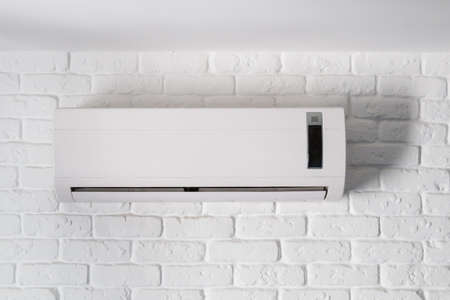 Air conditioner indoor unit mounted on loft style brick wall