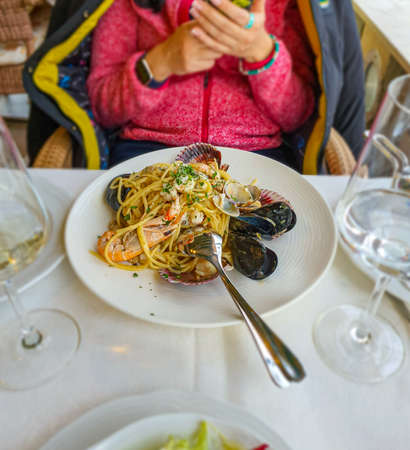 Selective focus of seafood pasta, mediterranean food, mobile photo