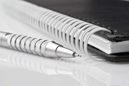writing materials: Notebook with silver pencil Stock Photo