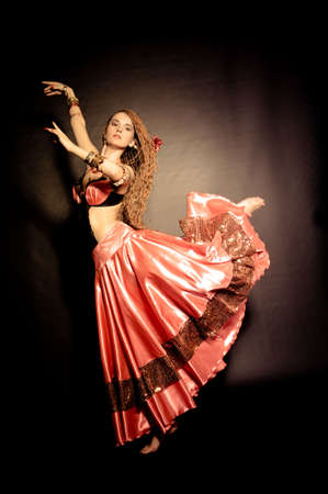 Flamenco dancer in red clothes photo