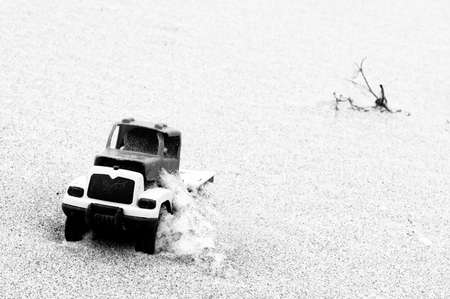 Toy car in sand  photo