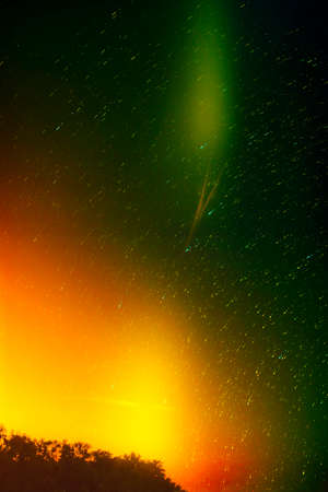 trails: Colorful green and yellow star sky with trails Stock Photo