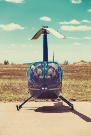 removed: Helicopter parked at the helipad. All logos and text removed. Stock Photo