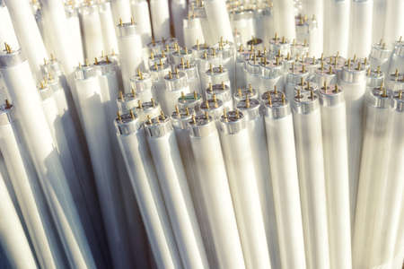 thrash: Fluorescent light tubes, electric pieces of rubbish, background Stock Photo