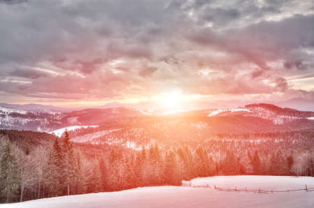 outdoorsman: View of sunset in the snowy mountains, ski slope