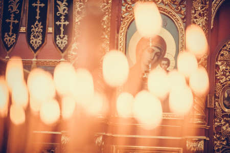 Candles firing in the church, close up Stock Photo