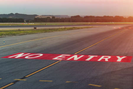 Landing light. Directional sign markings on the tarmac of runway at a commercial airport