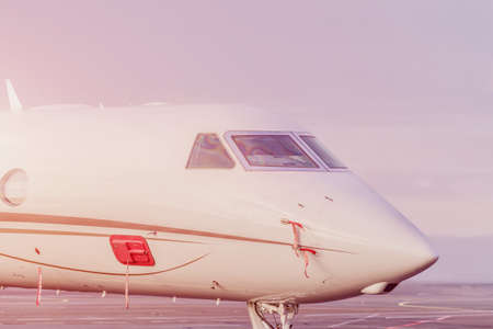 Private jet plane parking at the airport. Private airplane at sunset, Banque d'images