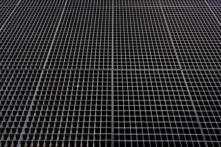 Metal mesh. Metallic background. Metallic mesh with square holes. Banque d'images