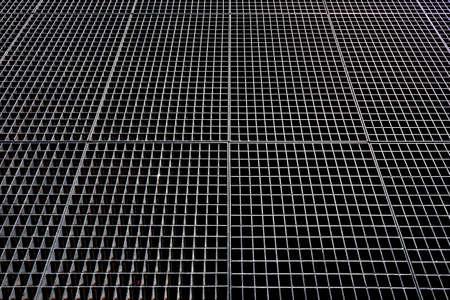Treillis métallique Fond métallique. Maille métallique avec des trous carrés. Banque d'images