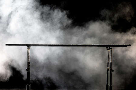 Closeup. Gymnastic parallel bars. Isolated on black background with fog, Banque d'images